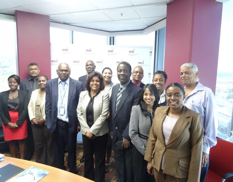 Minister Gopee-Scoon (centre) with newly appointed members of the National Trade Facilitation Committee