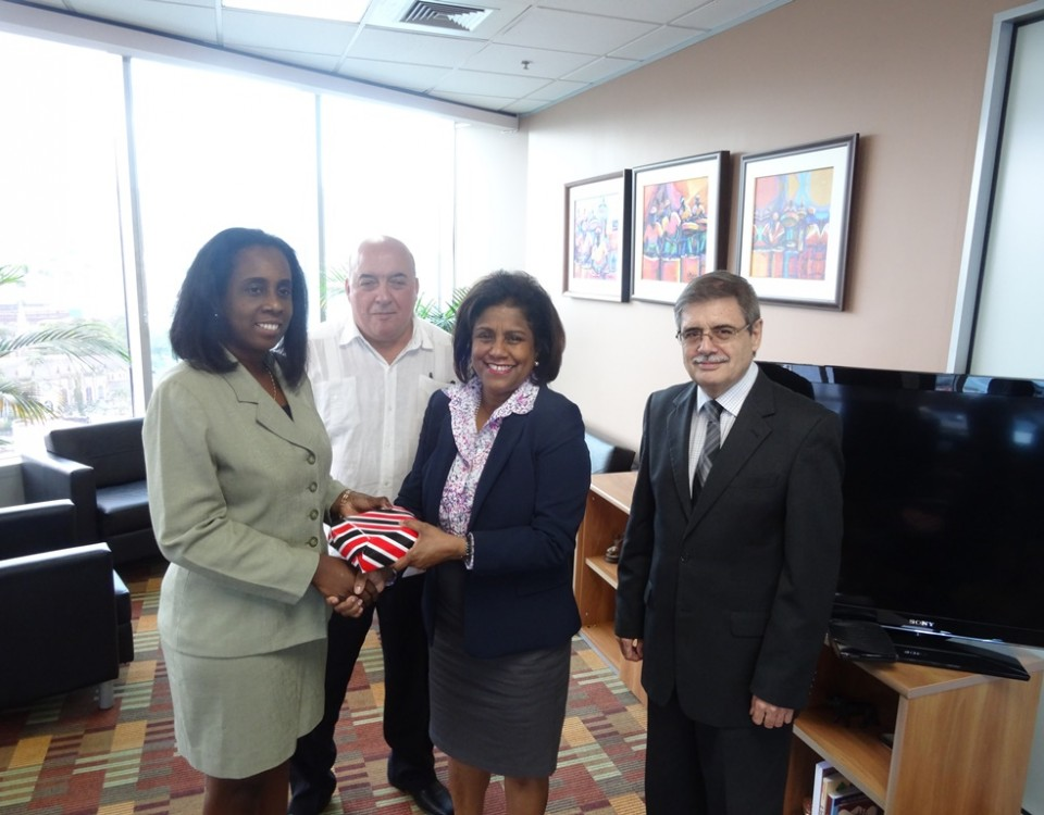 Minister of Trade and Industry, the Honourable Paula Gopee-Scoon (2nd from right) presents a token to the Honourable Ileana Bárbara Núñez Mordoche, Vice Minister in the Ministry of Foreign Trade and Investment, Cuba (l), while His Excellency Mr. Guillermo Vázquez Moreno, Cuban Ambassador (r) looks on