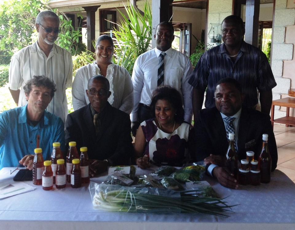 l-r: Gabrielle deGatano, Assemblyman Adams, Senator Gopee-Scoon, Assemblyman Jack.  Back row – Project beneficiaries