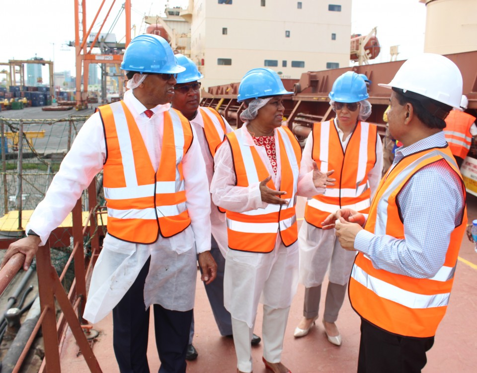 Minister Gopee- Scoon is flanked by Chairman Romano and Senior Executives of NFM while on tour the MVF Kushiro vessel which delivered wheat to NFM