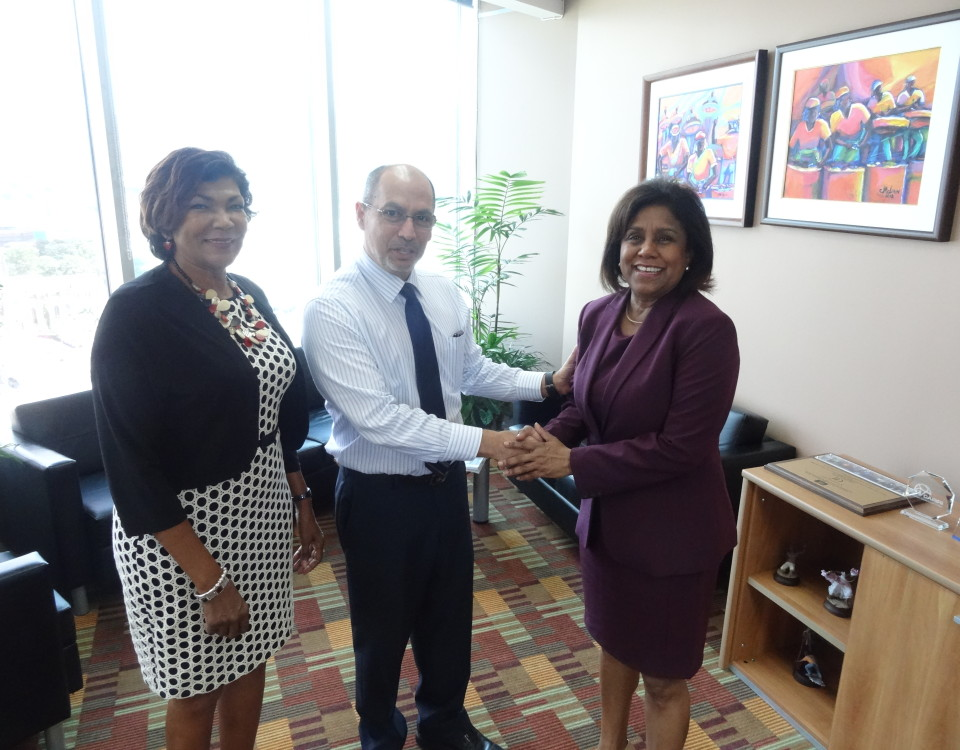 Trade Minster congratulates incoming CEO, Mr. Gabriel Faria (centre) as Ms. Catherine Kumar looks on