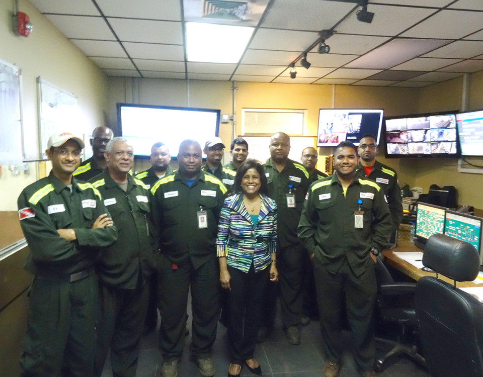 Minister Gopee-Scoon with staff members of the Control Room at Nu-Iron