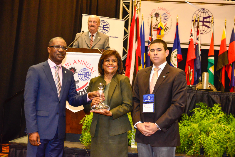 Minister Gopee-Scoon is presented with a token of appreciation by Mr. David Jean Marie, President, CSA (left), as Mr. Juan Carlos Croston, Vice President, Marketing looks on (right)