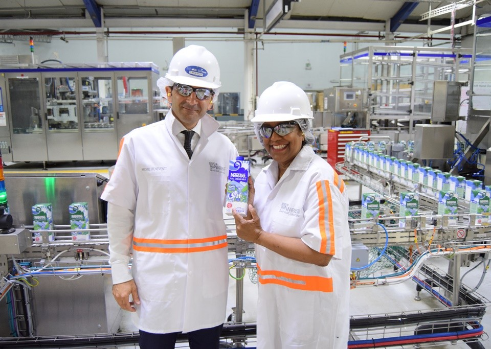 Trade Minister displays a carton of Nestle´ Full Cream Milk with Country Manager
