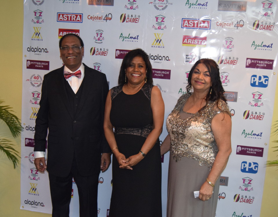 Trade and Industry (centre) with Mr. Trevor Joseph, Managing Director T&Z (left) and wife, Ms. Joseph (right) during the celebration