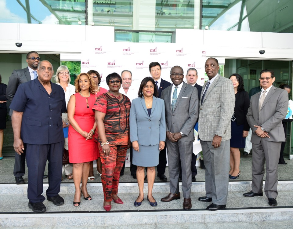 Trade and Industry Minister (centre) flanked by the Honourable Camille Robinson-Regis, Minister of Planning and Development (left), the Honourable Maxie Cuffie, Minister of Public Administration and Communications (right), Honourable Brigadier General Ancil Antoine, Member of Parliament for D'Abadie/O'Meara;and members of the diplomatic corps