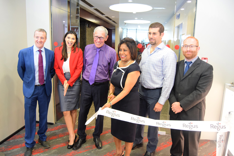 Senator the Honourable Paula Gopee-Scoon, Minister of Trade and Industry, participates in the ribbon cutting ceremony