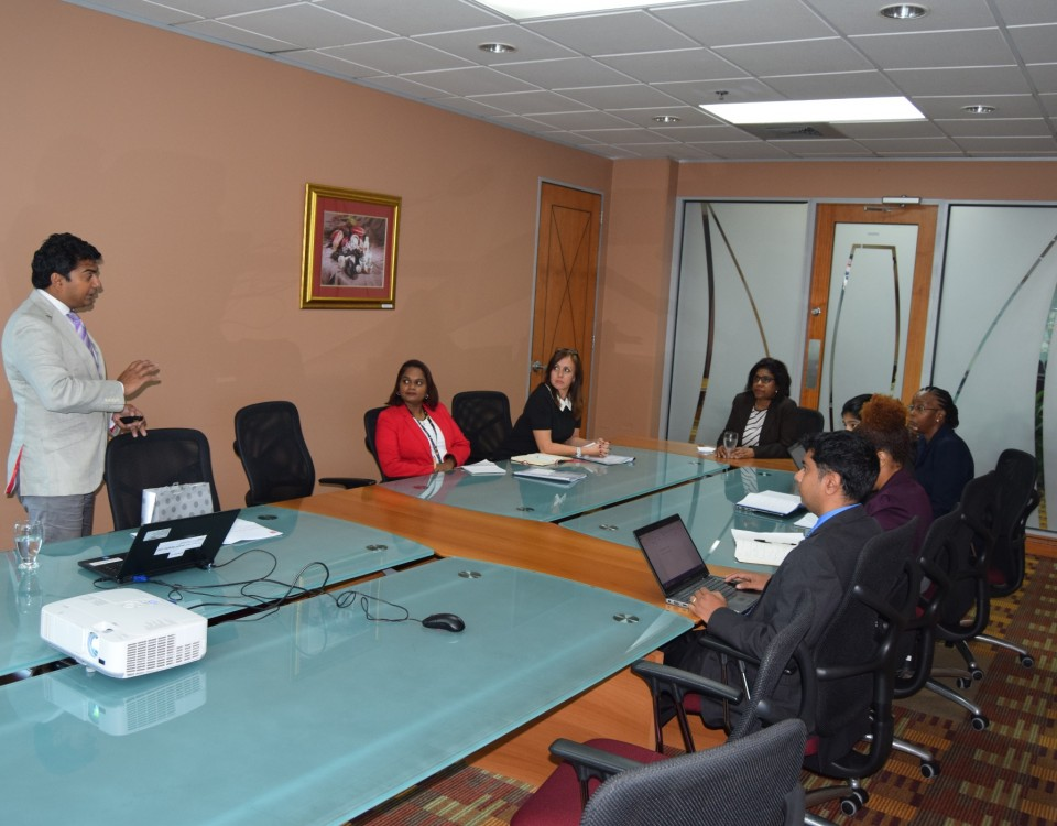 Mr Ashley Parasram, Director Trinidad and Tobago Fine Cocoa Company shares an overview of the company's operations and opportunities for partnership with the Ministry of Trade with Senator the Honourable Paula Gopee-Scoon