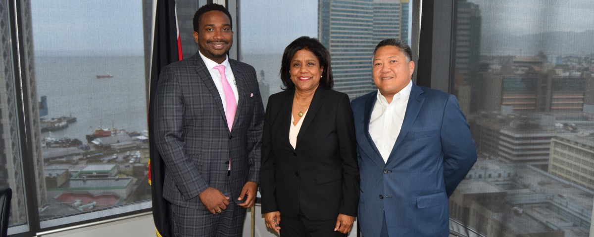 Trade Minister (centre) flanked by Mr. Aldwyn Wayne (CEO) (left) and Mr. Andre Aleong, Chief Operations Officer, WiPay (right) following discussions