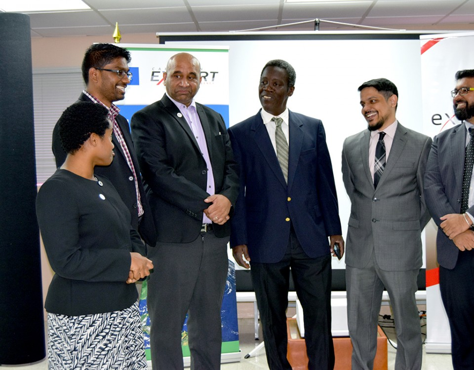 Discussing Export Competitiveness: Permanent Secretary Mr Norris Herbert centre in discussion with staff of exporTT including CEO Mr Dietrich Guichard 3rd and representatives of the Caribbean Export Development Agency at the launch of exporTT's Competiveness Project at Export House in Port of Spain on Tuesday.