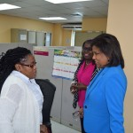 Trade & Industry Minister and Chief Trade Officer interacts with a staff member during the visit