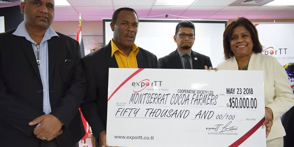 l-r Chief Executive Officer-exporTT Mr Dietrich Guichard, President Montserrat Cocoa Farmer's Co-operative - Mr Christopher Paul, Chairman exporTT - Mr Ashmeer Mohamed and Minister of Trade and Industry - Senator the Honourable Paula Gopee-Scoon at the recent handing over of $50,000 to the Cocoa Farmer's Cooperative to support their Geographical Indication recognition efforts for Trinidad Montserrat Hills Cocoa.