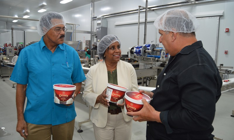 l-r Mr Anthony Banfield General Manager – Creamery Novelties, Minister of Trade and Industry Senator the Honourable Paula Gopee-Scoon and Mr Robert Hadad-Co-Chief Executive Officer Hadco examine a product from the new line of ice cream now on the local market at a recent tour of the Creamery Novelties factory in Diego Martin.
