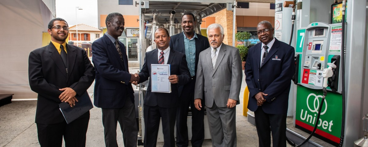 PS Norris Herbert (2nd left) presents the Verification Certificate to Dr Afraz Ali, Chairman of UNIPET. They are accompanied by Mr Lawford Dupres, Chairman of the TTBS (2nd right) and other senior representatives.