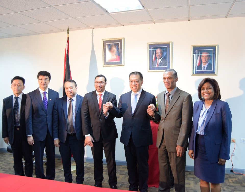 Vice Mayor of Beijing, His Excellency Wang Ning (c) with the Honourable Stuart Young, Minister of Communications and Minister in the Office of the Prime Minister and in the Ministry of the Attorney General and Legal Affairs (4th left) and Senator the Honourable Dennis Moses, Minister of Foreign and CARICOM Affairs (2nd right) and Trade and Industry Minister, Paula Gopee-Scoon (right).