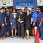 Staff at the Unicomer's new South Park branch pose alongside the Minister of Trade and Industry Senator the Honourable Paula Gopee-Scoon