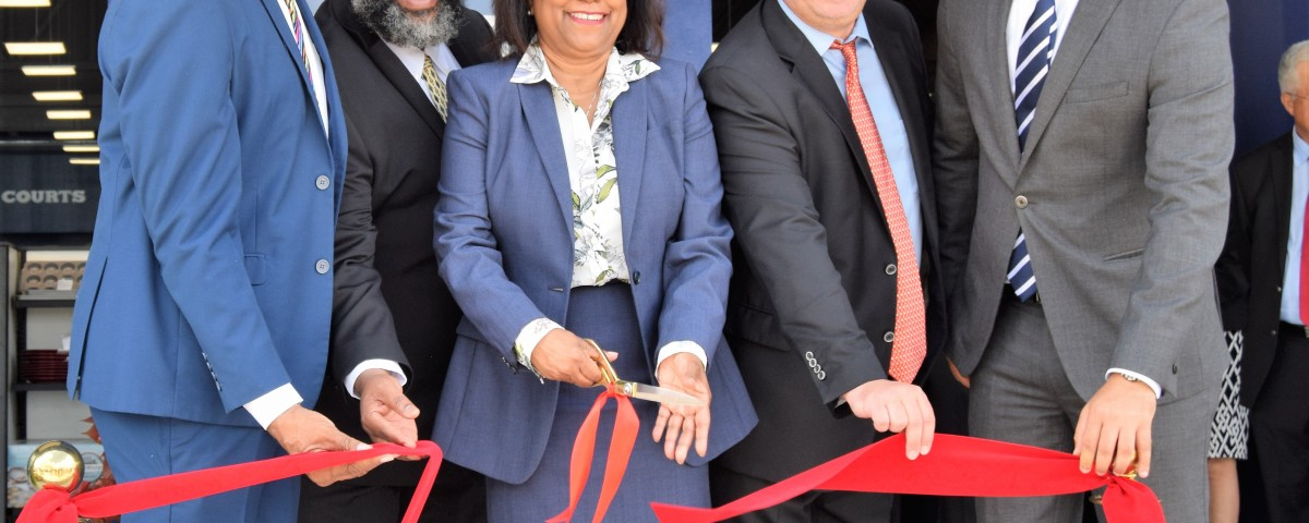 Minister of Trade and Industry Senator the Honourable Paula Gopee-Scoon cuts the ribbon at the opening of Unicomer (Trinidad) South Park branch on September 19, 2018 alongside San Fernando Mayor, Mr Errol Le Blanc, Mr Clive Fletcher and Member of Parliament Randall Mitchell