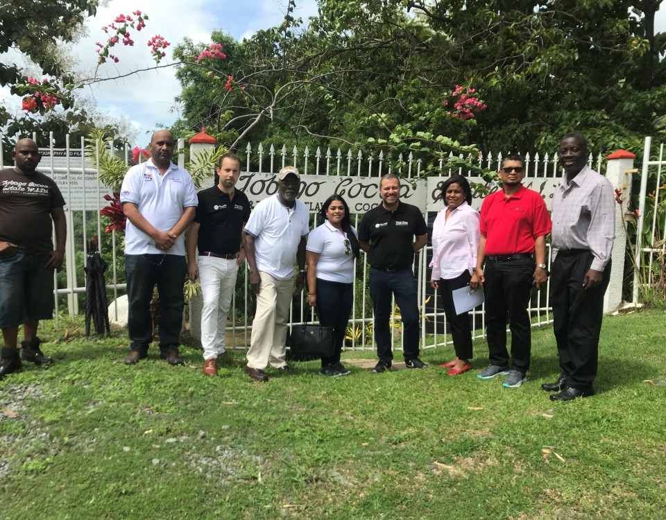 Right to left: Permanent Secretary at the Ministry of Trade and Industry - Mr Norris Herbert, Mr Ashmeer Mohamed- exporTT Chairman, Minister of Trade and Industry Senator the Honourable Paula Gopee-Scoon and Mr Duane Dove pose along with directors and staff of exporTT and Tobago Cocoa Estates Limited during a recent visit to advance an exporTT co financing project with the enterprise.
