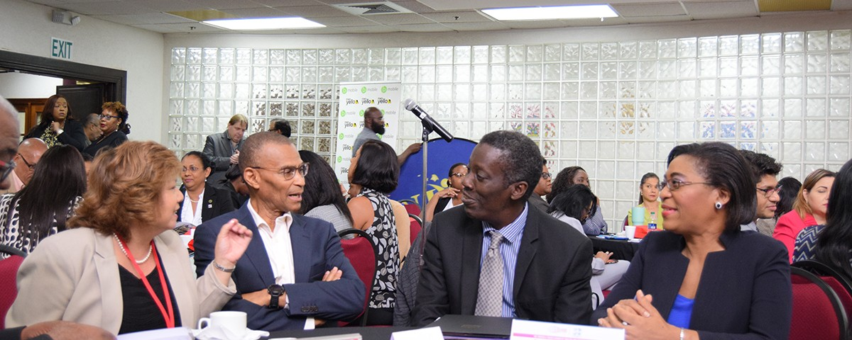 (L-R) Ms. Angela Lee Loy shares a light moment with President of the Trinidad and Tobago Chamber of Industry and Commerce Mr Ronald Hinds, Permanent Secretary Mr Norris Herbert, and Ms Natalie Willis Permanent Secretary Acting Ministry of Labour and Small Enterprise Development during the T&T Chambers first Human Resource conference held on November 8, 2018.