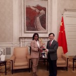 Beijing Vice Mayor His Excellency Yin Yong presents a token to Minister of Trade and Industry Senator the Honourable Paula Gopee-Scoon during a courtesy call in Beijing China on October 31, 2018.