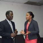 PS Herbert, MTI (left) in discussion with Ms. Andrea Davis- Country Manager DHL Caribbean (right)