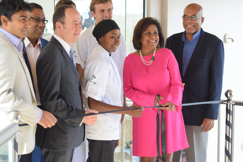 (l-r) Mr Ashley Parasram T&T Fine Cocoa Company Director, His Excellency Tim Stew –British High Commissioner to Trinidad and Tobago, local chocolatiers, Trade and Industry Minister, Paula Gopee-Scoon and Mr Winston Rudder of the Cocoa Development Company cut the ribbon to open the Chocolate Box at the Hilton Trinidad and Conference Centre.